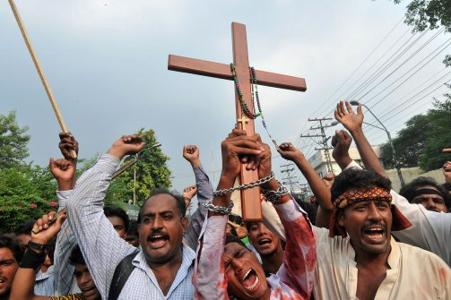 akistanis protest against violence against Christians in Lahore on Sept. 24, 2013. (Arif Ali/AFP/Getty Images)